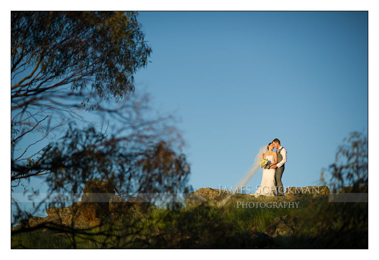 bride and groom on top of a mountain in the countryside perth