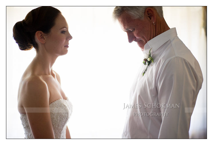 dad having a moment when he sees his daughter dressed for her wedding