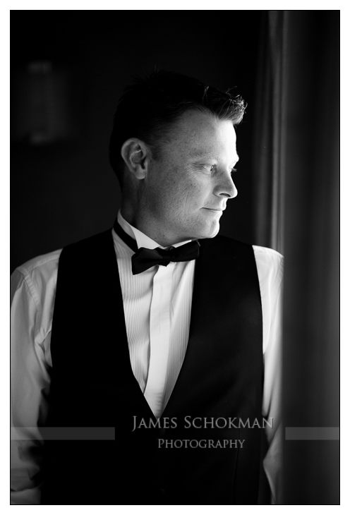 groom candid portrait wedding in perth hyatt